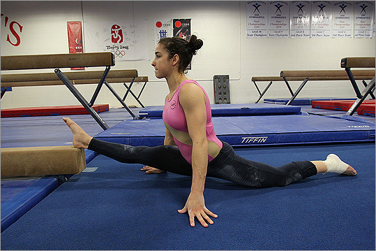 Aly Raisman While training , the Olympic gold medal winner spent at least seven hours in Brestyan's Gymnastics in Burlington four days a week - double sessions at 8:30 a.m. and 5 p.m. - plus three-hour morning workouts on Wednesday and Saturday. Raisman lived in Needham but it became impractical for Raisman to juggle academics and gymnastics, which caused her to miss 50 days of school last year. So Raisman attended senior year online at Needham High, getting much of her work done on weekends. Raisman is pictured training in Burlington in January.