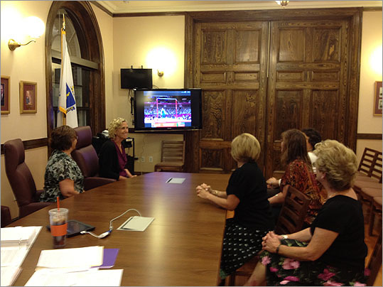 Town employees were spotted watching the Raisman and the Olympics during work hours.