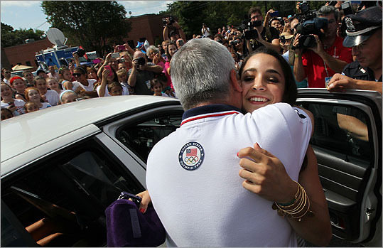 Raisman hugged coach Mihai Brestyan as soon as she arrived.
