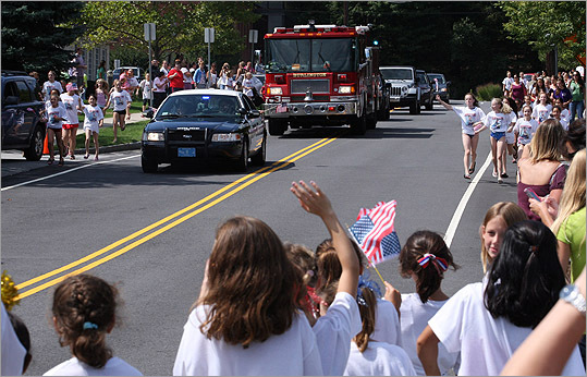Locals in a police car and fire truck escorted Raisman to her Burlington gym appearance. 'It hasn't even been a day with her home yet,' said Raisman's Father, Rick, adding that the two have barely had time to talk. 'It's the first night she's been home in over a month.'