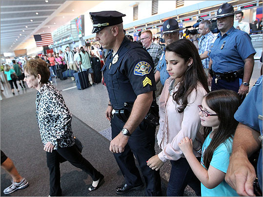 After she was done, she was escorted by both Needham and State Police as she walked to a waiting limo outside of Terminal A.