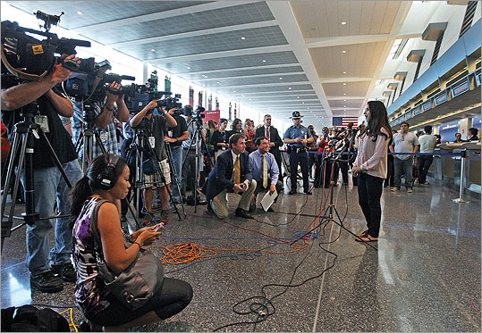 She spoke to the assembled media in Terminal A as airport patrons and workers watched the action.