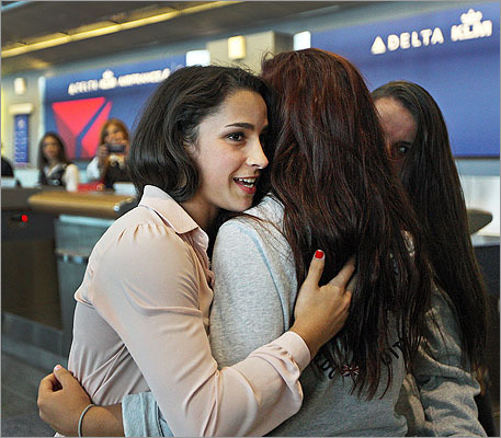 After she spoke she was greeted by some of her friends who came to Terminal A to welcome her home.