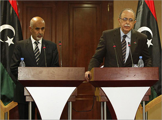 Libya's Prime Minister Abdurrahim El-Keib (right) and the head of the national assembly, Mohammed Magarief (left), attended a news conference in Tripoli on Sept.12.