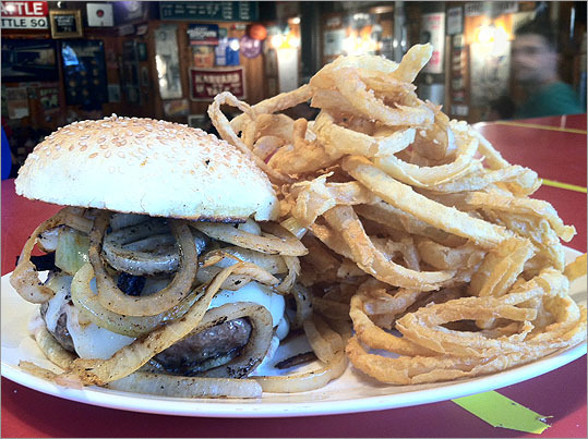 Mitt Romney Burger The presidential candidate rival on the menu is named for the former governor. The menu lists the Romney as: '(2012 or bust)' with Swiss cheese, grilled onions and onion rings. The price is slightly more expensive at $11.70.