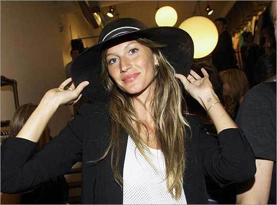 New England Patriots quarterback Tom Brady isn't the only star in his marriage. His wife, supermodel Gisele Bundchen, is a star, too. But that's not why she has one tattooed on her wrist. The star is actually a reminder of the model's grandmother, she told InStyle magazine : 'When I first moved to New York there were no stars in the sky, so to remind me of her I drew one on my wrist and kept it there for a month, and then had someone draw it in.'