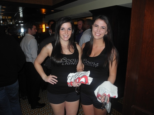 Kaitlin and Caitlin from Coors Light hanging out at Clery's rewarding Coor's drinkers with swag.