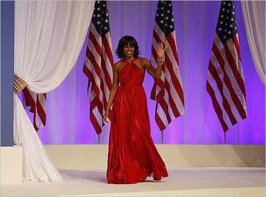 Mrs. Obama emerged at the inaugural ball in velvet and chiffon as a bona fide trendsetter. She wore a custom-made, ruby red, Jason Wu gown. The red halter dress was the only one Wu submitted for Mrs. Obama's consideration. He collaborated with jeweler Kimberly McDonald on the jeweled neckline. ''For this occasion, it had to be real diamonds,'' Wu said.