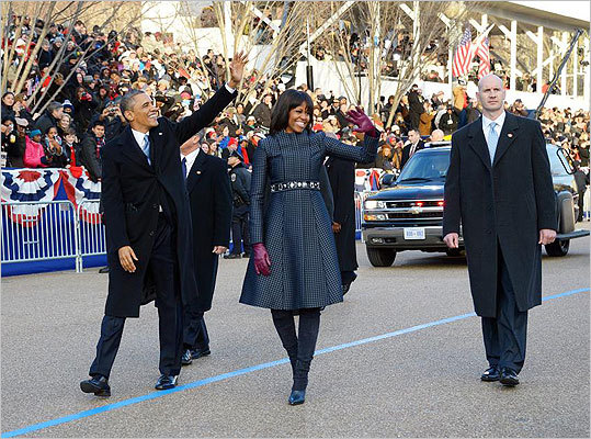 Mrs. Obama led a fashion parade following the inauguration in a navy-silk, checkered-patterned coat and dress by Thom Browne on Jan. 21. The rest of Mrs. Obama's Inauguration Day outfit included a belt from J. Crew, necklace by Cathy Waterman and a cardigan by Reed Krakoff. More on inaugural fashion