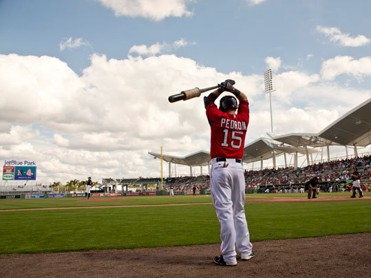 Dustin Pedroia in the on deck circle during a game against Northeastern University at JetBlue Park.