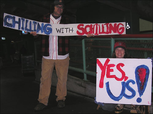 Dave and Lynn Waller of Malden had some help from their 8-year-old to make their sign. They 'love Curt for going through that much pain and trauma' for his team. They don't think we'll see the Sox back at Fenway until 2005.