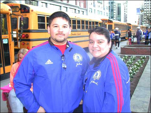 Eliott and Cindy Dejesus from Revere are Boston Athletic Association volunteers and help to get the runners on the buses. This is the tenth time Cindy has helped out on marathon day and loves the tradition.