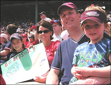 The Kiley family from Northborough were among those who flocked to Fenway Park on Patriots Day to watch the Red Sox play the Yankees. After enjoying the game, the Kileys rushed to Kenmore Square to watch the runners finishing the last stretch of the Boston Marathon. They were nice enough to let us tag along, so let's follow Ed and Kelly Kiley, and their daughters Bridget (front) and Maggie, as they spend a day rooting for the Sox and cheering for the marathoners.