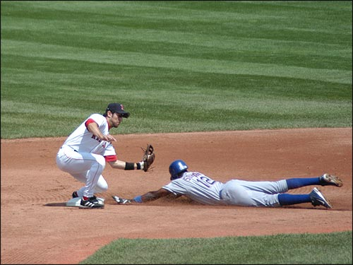 Nomar brings down a tag on Alfonso Soriano of the Texas Rangers. (Photo submitted by Mike in Natick)