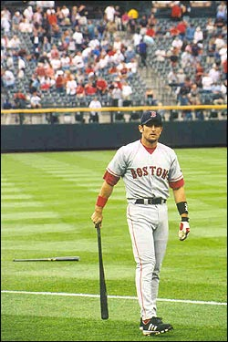 Nomar swings a bat before facing off against the Rockies in June. (Photo submitted by Kenneth Leisher)