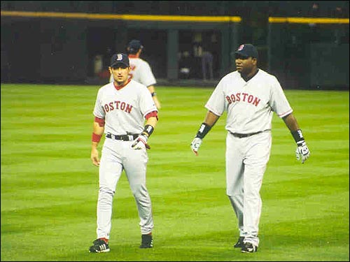 Nomar strides across the outfield with designated hitter David Ortiz before a game at Coors Field in June. (Photo submitted by Kenneth Leisher)