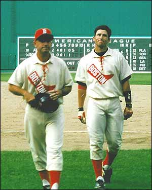 Dressed in throwback uniform and accompanied by a coach, Nomar smiles grimly as he leaves the field after his hit streak ended in his rookie season of 1997. (Photo submitted by Steve Rogan)
