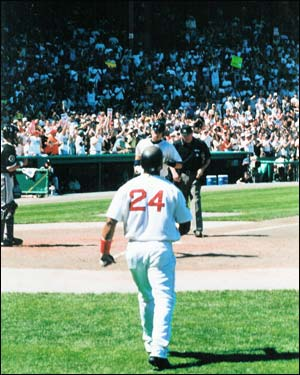 Nomar crosses the plate at Fenway after hitting a home run in his first game back after his wrist injury in 2000. Manny Ramirez waits to congratulate him. (Photo submitted by Steve Rogan)