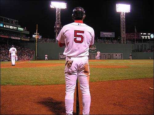 Nomar rests his bat on the Fenway dirt last September when the Sox took on the Orioles and Todd Walker hit a three-run shot in the ninth to tie the game up. (Photo submitted by Tom in Brookline)