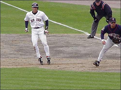 Nomar takes a lead from first baseman and future Red Sox Doug Mientkiewicz during this matchup of the Sox and the Minnesota Twins. (Photo submitted by Mike Swartz)