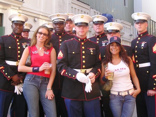Danielle and Rosi love the men in uniform from the 1st Battalion 25th Marine Regiment in Portsmouth, N.H. They don't love the men in pinstripes but want to see them here over the Twins.