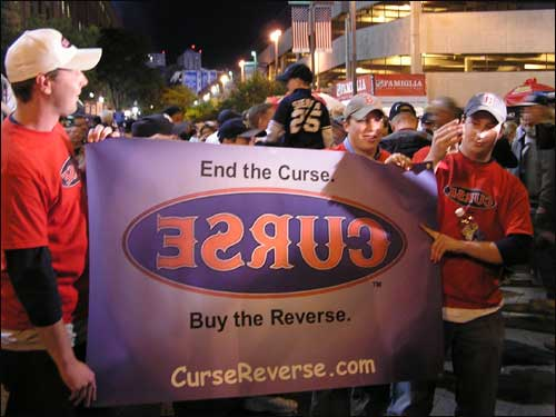 "The ""Reverse the Curse"" crew takes the opportunity of Game 1 of the ALCS to hawk their merchandise outside of Yankee Stadium."