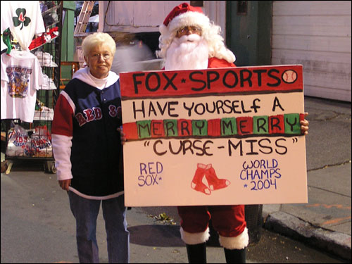 "It's Christmas in October at Fenway Park. Well, not really after Saturday night's result. But Pat Sullivan and Fred ""Santa"" Carbone from the Cape are still keeping the faith."