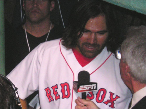 Johnny Damon, hitting only .083 for the series, comes out to face the music with ESPN's Peter Gammons after he scored the winning run.