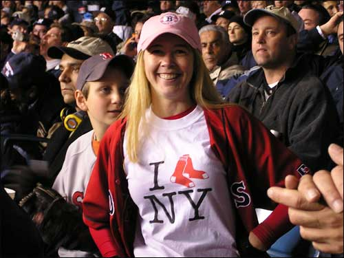Sox rooters Diane Garnick, who lives in midtown Manhattan, and her 'date' for the game, 11-year-old Harley Borish of Manhattan, kept positive attitudes. Garnick, a NY native, became a diehard Sox fan during three years she lived in Boston.