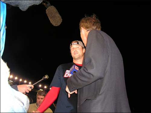 Game 7 winner Derek Lowe is the center of attention after the game. Banished to the bullpen at the start of the playoffs, Lowe started two of Boston's four wins.