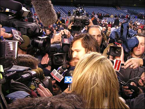 Game 7 hero Johnny Damon, who set an ALCS record with six RBIs in one game, is surrounded by a media horde.