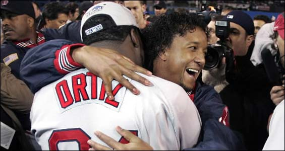 Pedro Martinez hugs David Ortiz after the Sox beat the Yankees for the American League pennant.