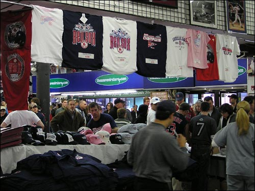 Fans mob the Twins Souvenir Shop across from Fenway Park to purchase American League Championship garb in time for the Red Sox' first World Series appearance in 18 years.