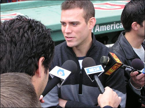 Boston general manager Theo Epstein handles the media throng at today's World Series workout for both teams.
