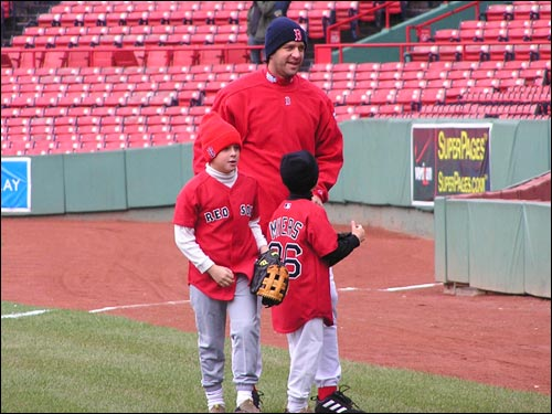 Lefty reliever Mike Myers walks in from the Fenway outfield after playing catch with his children.