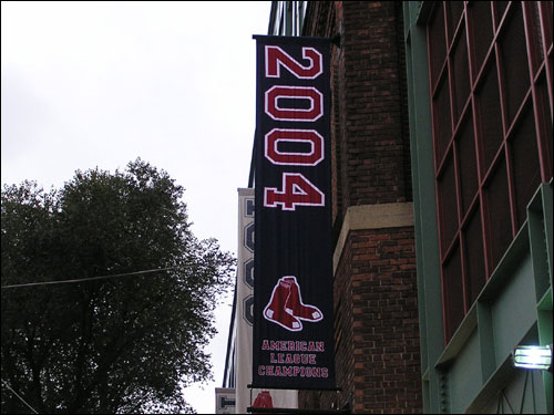 Isn't this a great sight? At some point between Wednesday's Game 7 win and Saturday's Game 1, the Sox hung their 2004 World Series banner alongside the rest on Yawkey Way.