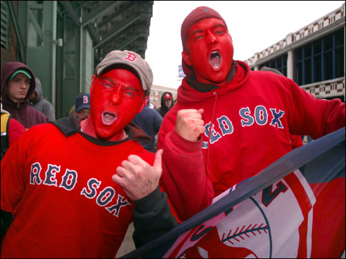With their faces painted Red Sox red, Johnny Cullen (left) from Marshfield and friend Anthony Brugnoli from Hanover try to get the crowd on Lansdowne Street pumped up as they stand in line, hoping for Sox tickets to go on sale. They had been waiting on Lansdowne since 3 p.m. Friday, along with several hundred other Sox faithful.