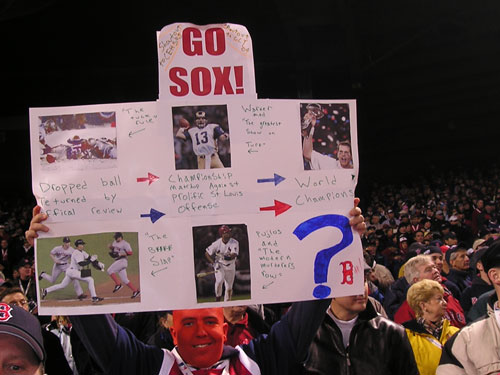 In case you hadn't noticed, sign carrying and face painting are all the rage at Fenway this October playoff season. This sign might have a little too much going on to make it on Fox.