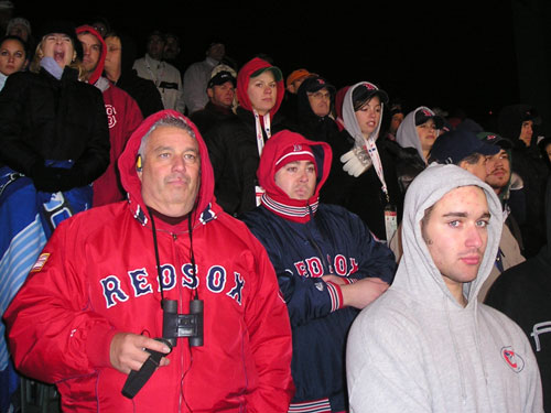 Fans watch the Sox blow a five-run lead from the cold and windy bleachers at Fenway on Saturday night. File under: Boys (and girls) in the hoods.