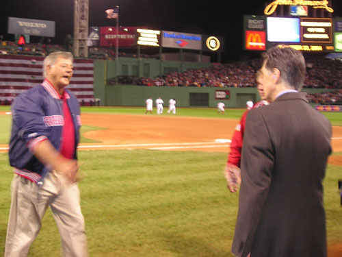 Captain Carl Yastrzemski walks toward Sox owner John Henry after he threw out the first pitch to start the 2004 World Series. Yaz was the star of the Red Sox' 'Impossible Dream' team in 1967.