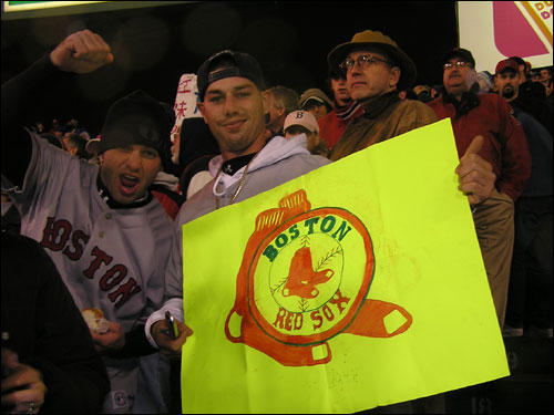 Everyone is an artist at Fenway these days. These guys were fired up to be in the bleachers no matter what the weather conditions were. It's a once in a lifetime opportunity to see the Sox, who have never played this late in October at Fenway.