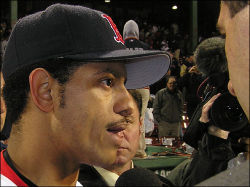 Orlando Cabrera talks to the spanish-speaking media after leading the Red Sox to a 6-2 win over St. Louis in Game 2 of the World Series. Cabrera was the third Sox batter to deliver a two-out, two-run hit on the night.