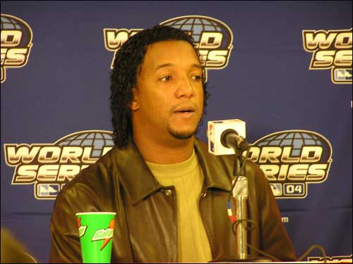 Pedro Martinez meets with the media following his win in Game 3. Martinez allowed just three hits over seven innings.
