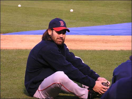 Johnny Damon gets in some stretching exercises on the field before game time.