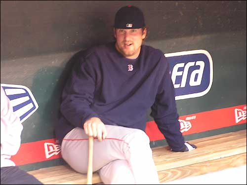 Derek Lowe appears as relaxed as can be, even with a bat in his hand, in the dugout before his Game 4 start.