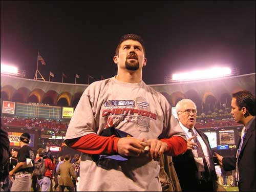 Red Sox catcher Jason Varitek seeks out his wife in the crowd.