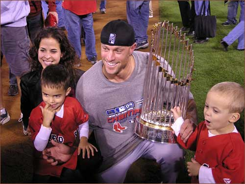 Gabe Kapler, wife Lisa, and their children pose with the World Series trophy.