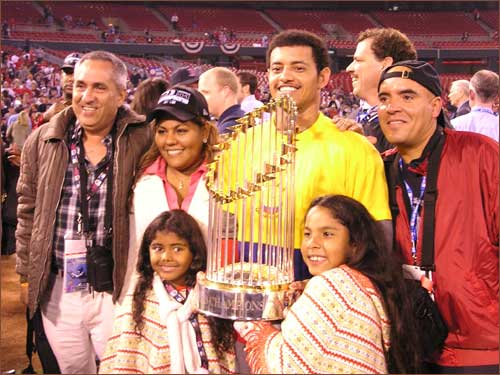 Orlando Cabrera and family pose with the World Series trophy.