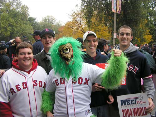 'Mung' (center) got a lot of attention with his lime green fur and Curt Schilling jersey. Pictured with him are, from left, Todd Coolidge, 20, of Hanniker, N.H., Kyle Gookin, 19, an Emerson College student, Matt Douville, 19, of Northbridge, Mass., and Jim Feenan, 19, of Windham, N.H.