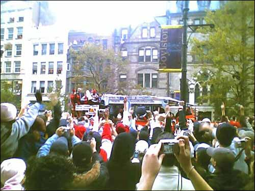 On the parade route everyone wants a picture. Here, from the front of the Boston Public Library, Scott Kirsner takes a picture of David Ortiz as he hoists the trophy in the air for the fans to see.